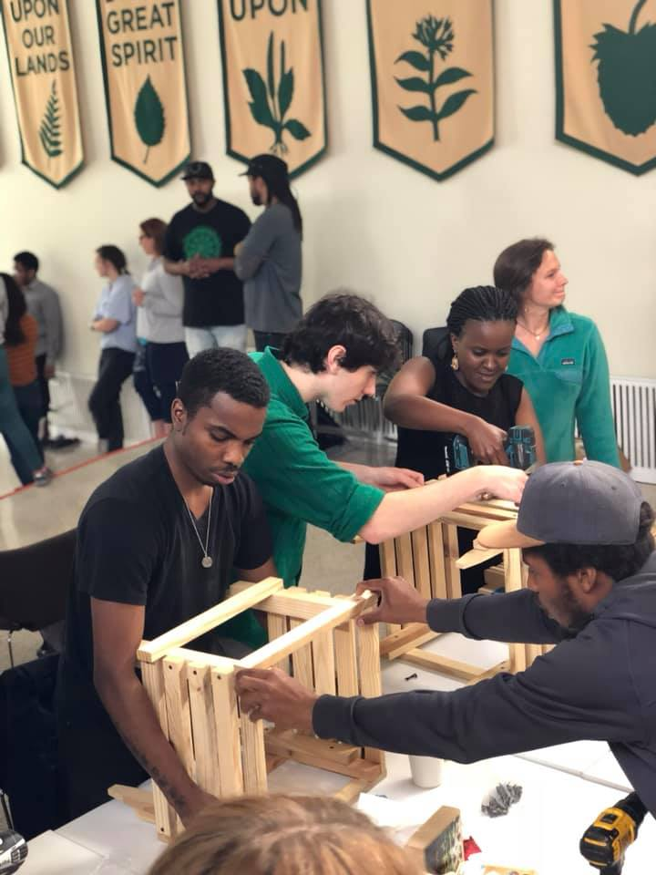 Students building wood crates